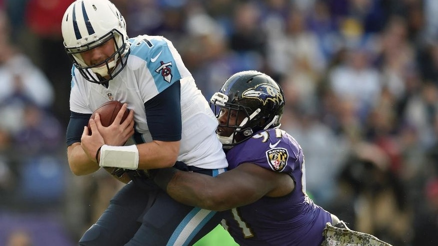 Tennessee Titans quarterback Zach Mettenberger (7) is sacked by Baltimore Ravens defensive tackle Timmy Jernigan (97) during the first half of an NFL football game in Baltimore, Sunday, Nov. 9, 2014. (AP Photo/Gail Burton)