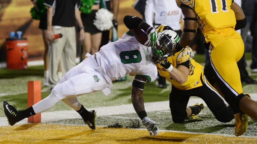 Marshall running back Remi Watson (8) is tackled by Southern Mississippi linebacker Terrick Wright (14) while scoring a touchdown in the first half during a NCAA college football game in Hattiesburg, Miss., Saturday, Nov. 8, 2014. (AP Photo/Steve Coleman)