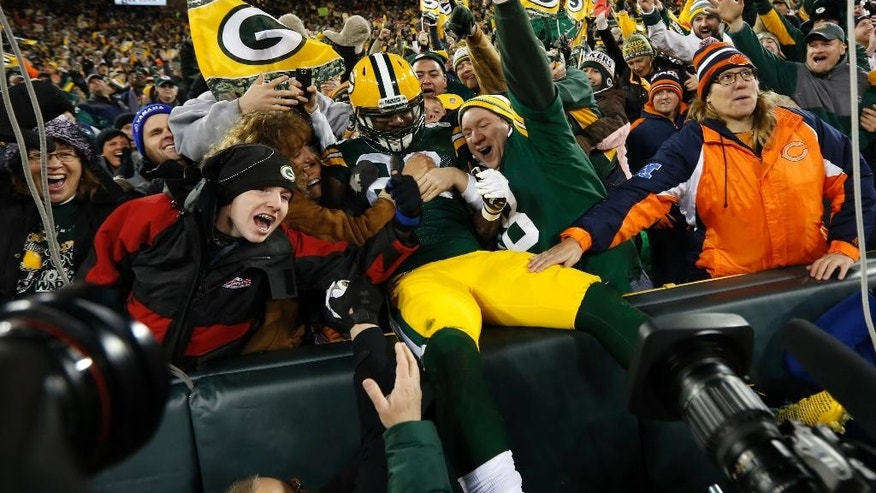Green Bay Packers tight end Brandon Bostick (86) celebrates a touchdown with fans during the first half of an NFL football game against the Chicago Bears on Sunday, Nov. 9, 2014, in Green Bay, Wis. (AP Photo/Mike Roemer)