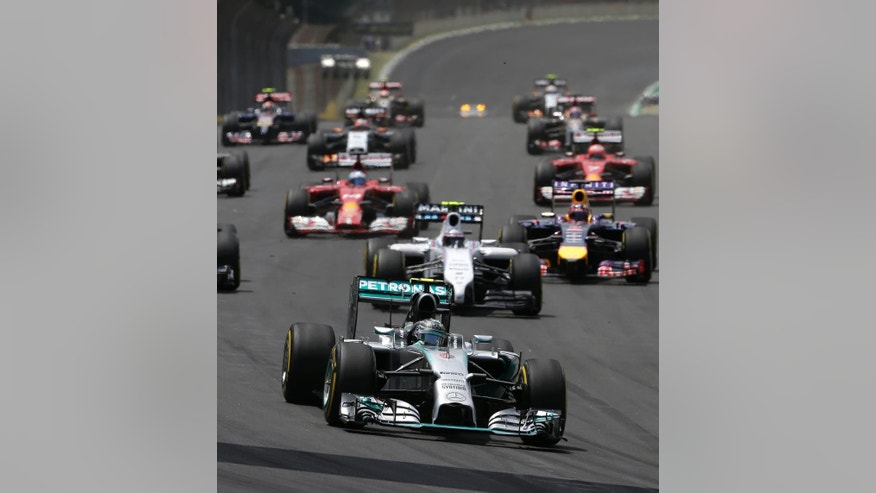 Mercedes driver Nico Rosberg of Germany leads the field during the Formula One Brazilian Grand Prix at the Interlagos race track in Sao Paulo, Brazil, Sunday, Nov. 9, 2014. (AP Photo/Felipe Dana)