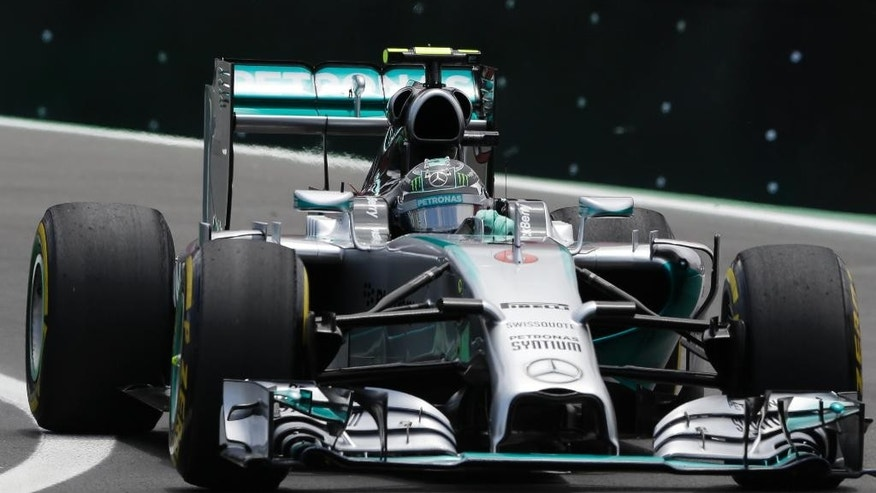 Mercedes driver Nico Rosberg, of Germany, steers his car on the pit lane prior to the start of the Formula One Brazilian Grand Prix at the Interlagos race track in Sao Paulo, Brazil, Sunday, Nov. 9, 2014. (AP Photo/Ricardo Mazalan)