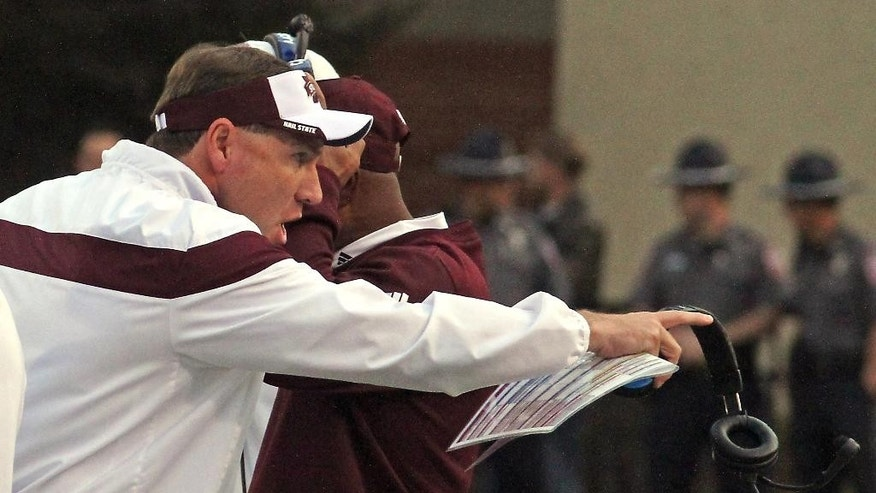 Mississippi State coach Dan Mullen shouts instructions to his team during the first half of an NCAA college football game against Tennessee-Martin in Starkville, Miss., Saturday, Nov. 8, 2014. Mississippi State won 45-16. (AP Photo/Jim Lytle)