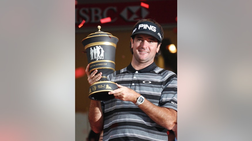 Bubba Watson of the U.S. celebrates with his champion trophy during the award ceremony of the HSBC Champions golf tournament at the Sheshan International Golf Club in Shanghai, China, Saturday, Nov. 9, 2014. Watson captured his first World Golf Championship. (AP Photo)