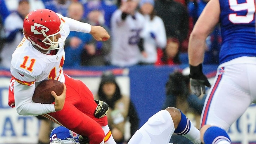 Kansas City Chiefs quarterback Alex Smith (11) is tackled by Buffalo Bills defensive end Jerry Hughes (55) during the first half of an NFL football game, Sunday, Nov. 9, 2014, in Orchard Park, N.Y. (AP Photo/Gary Wiepert)