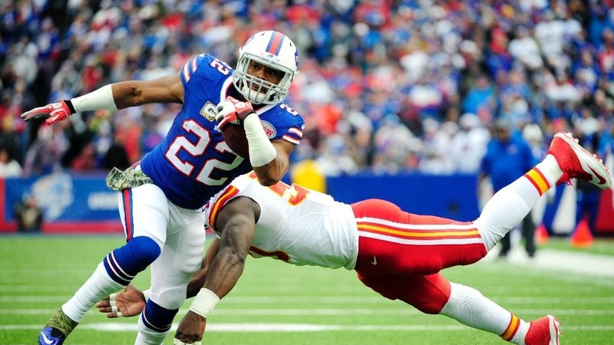 Buffalo Bills running back Fred Jackson (22) runs with the ball as Kansas City Chiefs outside linebacker Justin Houston tries to make a tackle during the first half of an NFL football game, Sunday, Nov. 9, 2014, in Orchard Park, N.Y. (AP Photo/Gary Wiepert)