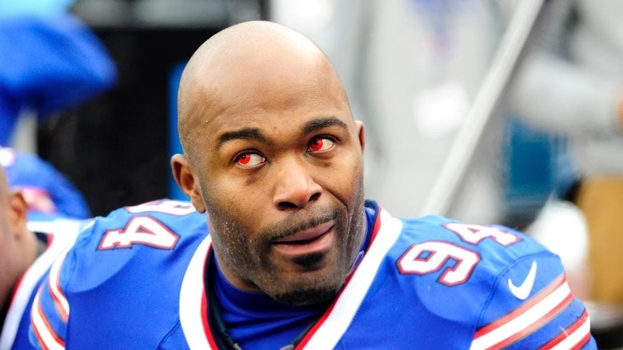 Buffalo Bills defensive end Mario Williams wears red contacts during the first half of an NFL football game against the Kansas City Chiefs, Sunday, Nov. 9, 2014, in Orchard Park, N.Y. (AP Photo/Gary Wiepert)