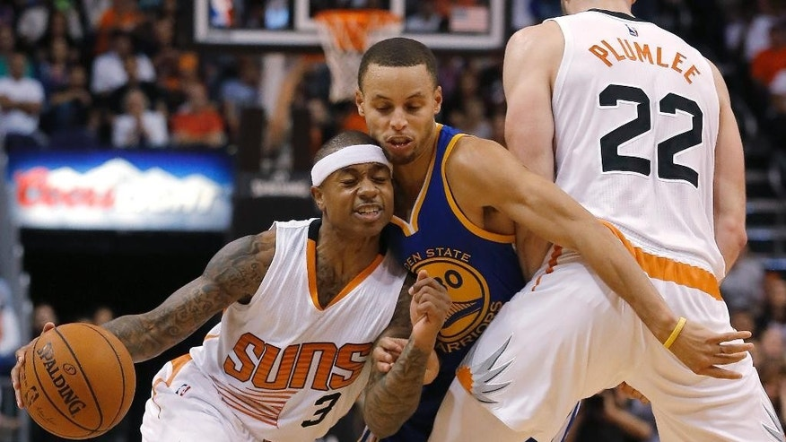 Phoenix Suns guard Isaiah Thomas (3) drives past Golden State Warriors guard Stephen Curry (30) on a pick by Miles Plumlee (22) during the second half of an NBA basketball game, Sunday, Nov. 9, 2014, in Phoenix. The Suns won 107-95. (AP Photo/Rick Scuteri)
