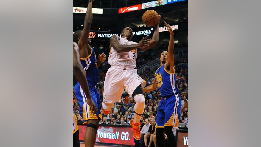 Phoenix Suns guard Eric Bledsoe (2) drives on Golden State Warriors guard Shaun Livingston, right, during the second half of an NBA basketball game, Sunday, Nov. 9, 2014, in Phoenix. The Suns won 107-95. (AP Photo/Rick Scuteri)