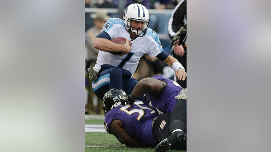 Tennessee Titans quarterback Zach Mettenberger (7) is sacked by Baltimore Ravens outside linebacker Terrell Suggs (55) during the second half of an NFL football game in Baltimore, Sunday, Nov. 9, 2014. (AP Photo/Patrick Semansky)