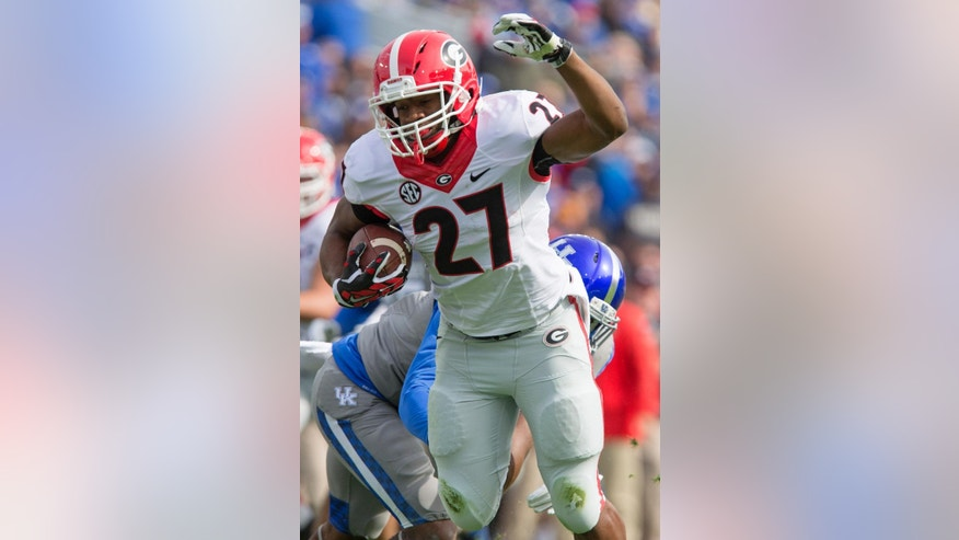 Georgia running back Nick Chubb runs into the end zone for a touchdown during the first half of an NCAA college football game against Kentucky at Commonwealth Stadium in Lexington, Ky., Saturday, Nov. 8, 2014. Georgia beat Kentucky 63-31. (AP Photo/David Stephenson)