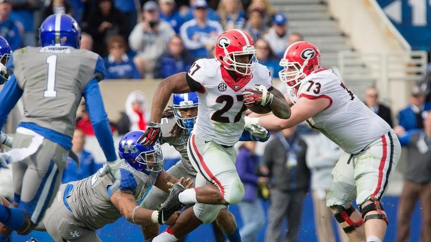 Georgia running back Nick Chubb gains some yardage against Kentucky during the first half of an NCAA college football game at Commonwealth Stadium in Lexington, Ky., Saturday, Nov. 8, 2014. Georgia beat Kentucky 63-31. (AP Photo/David Stephenson)