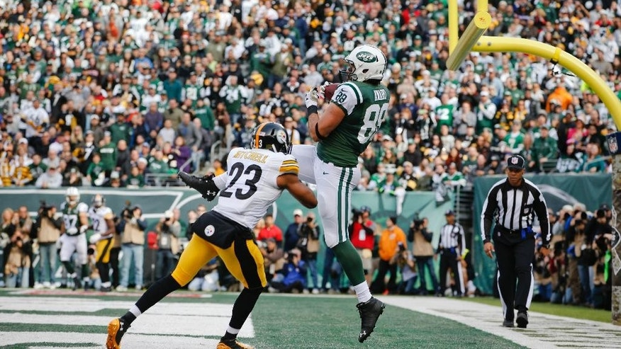 New York Jets tight end Jace Amaro (88) catches a pass for a touchdown in front of Pittsburgh Steelers' Mike Mitchell (23) during the first half of an NFL football game Sunday, Nov. 9, 2014, in East Rutherford, N.J. (AP Photo/Kathy Willens)