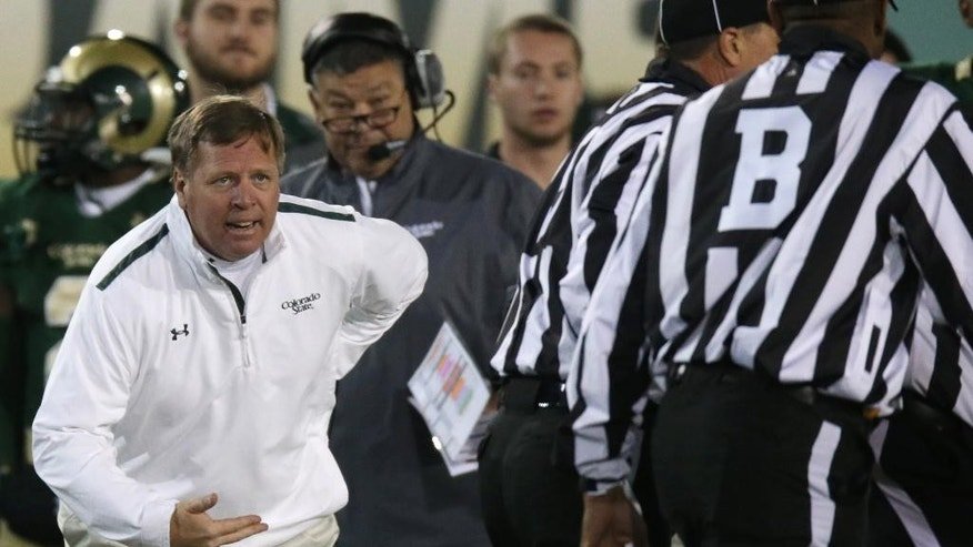 Colorado State coach Jim McElwain discusses a call with officials during the first quarter of an NCAA college football game against Hawaii in Fort Collins, Colo., on Saturday, Nov. 8, 2014. (AP Photo/David Zalubowski)