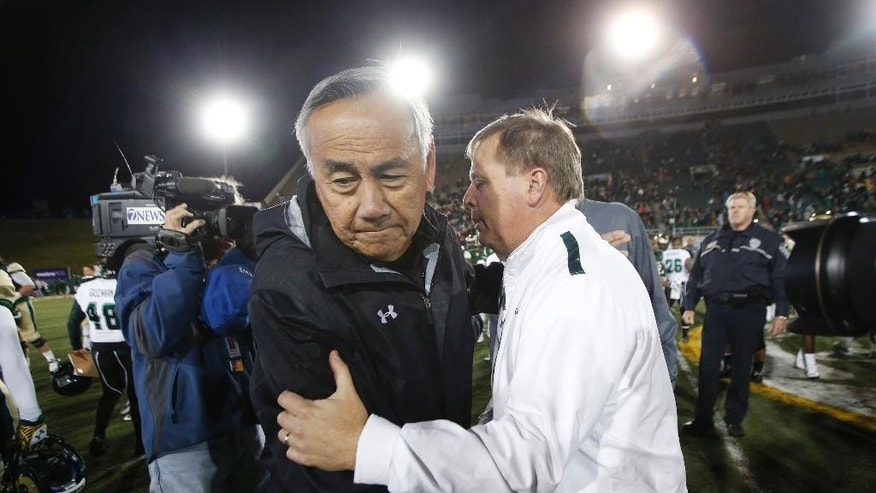 Hawaii coach Norm Chow, left, greets Colorado State coach Jim McElwain after Colorado State's 49-22 victory in an NCAA college football game in Fort Collins, Colo., on Saturday, Nov. 8, 2014. (AP Photo/David Zalubowski)