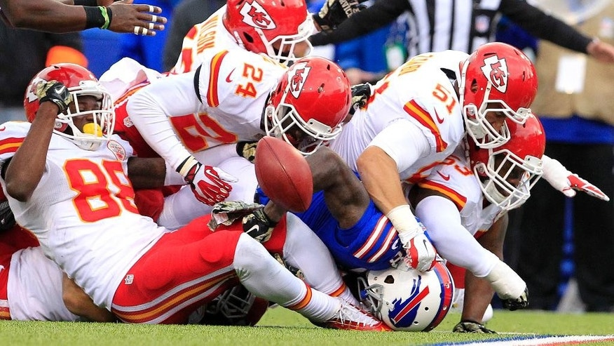 Buffalo Bills wide receiver Marquise Goodwin, center bottom, loses the ball as Kansas City Chiefs defend during the second half of an NFL football game, Sunday, Nov. 9, 2014, in Orchard Park, N.Y. Goodwin was ruled down before losing the ball. The Chiefs won 17-13. (AP Photo/Bill Wippert)