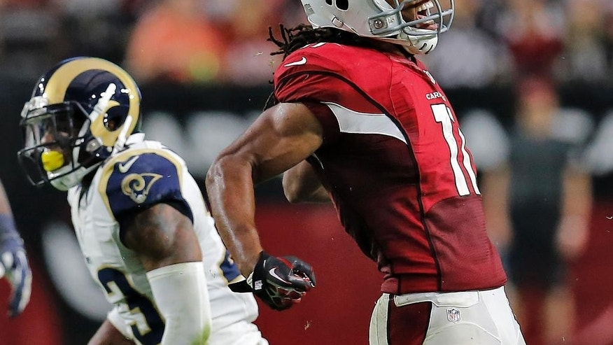 Arizona Cardinals wide receiver Larry Fitzgerald (11) reacts after a first down gain against the St. Louis Rams during the second half of an NFL football game, Sunday, Nov. 9, 2014, in Glendale, Ariz. The Cardinals won 31-14. (AP Photo/Rick Scuteri)