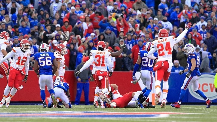 Kansas City Chiefs players celebrate after  Anthony Sherman recovered a fumble on a punt return by the Buffalo Bills during the second half of an NFL football game, Sunday, Nov. 9, 2014, in Orchard Park, N.Y. The Chiefs won 17-13. (AP Photo/Bill Wippert)