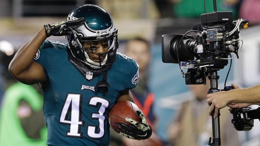 Philadelphia Eagles' Darren Sproles celebrates after scoring a touchdown during the first half of an NFL football game against the Carolina Panthers, Monday, Nov. 10, 2014, in Philadelphia. (AP Photo/Michael Perez)