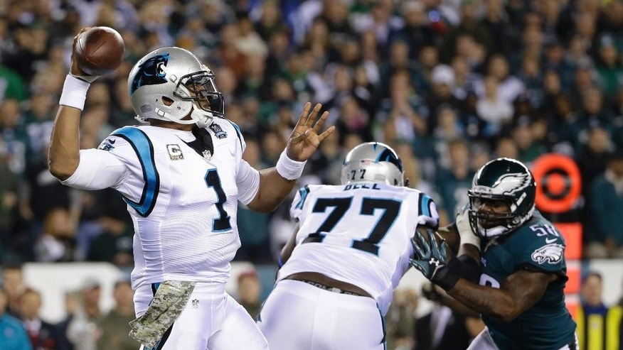 Carolina Panthers' Cam Newton passes during the first half of an NFL football game against the Philadelphia Eagles, Monday, Nov. 10, 2014, in Philadelphia. (AP Photo/Matt Rourke)