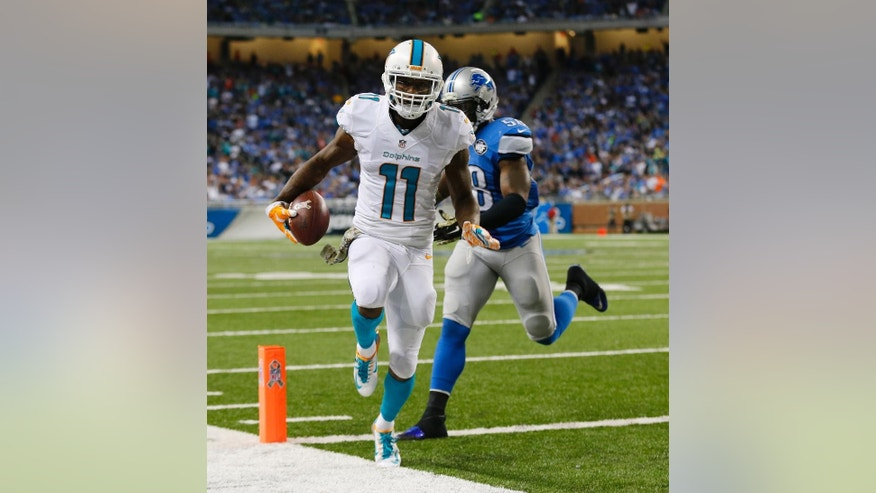 Miami Dolphins wide receiver Mike Wallace (11) outruns Detroit Lions outside linebacker Ashlee Palmer (58) for a touchdown during the second half of an NFL football game in Detroit, Sunday, Nov. 9, 2014. (AP Photo/Paul Sancya)