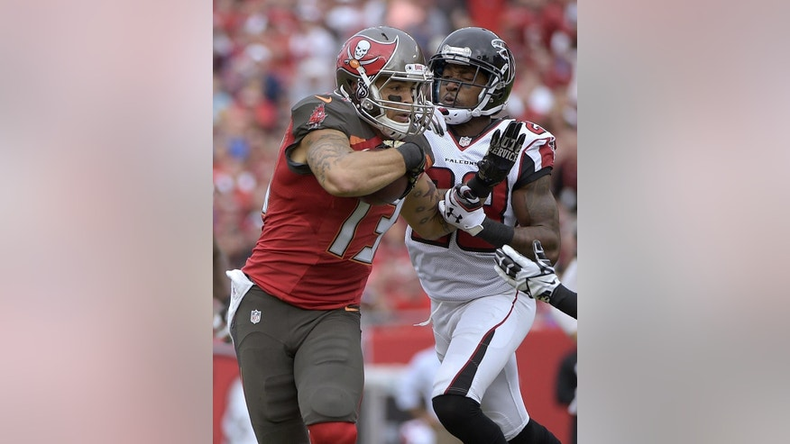 Tampa Bay Buccaneers wide receiver Mike Evans (13) is stopped by Atlanta Falcons cornerback Robert Alford (23) after a reception during the fourth quarter of an NFL football game Sunday, Nov. 9, 2014, in Tampa, Fla. (AP Photo/Phelan M. Ebenhack)