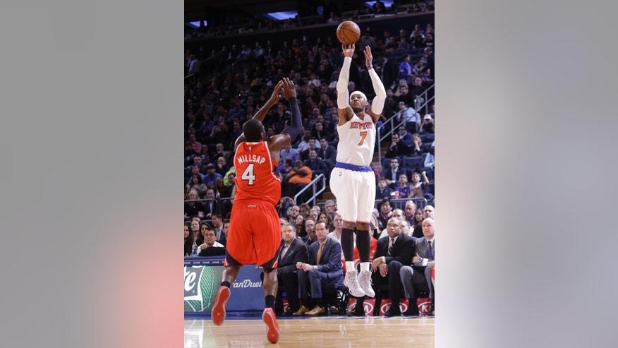 New York Knicks' Carmelo Anthony (7) shoots over Atlanta Hawks' Paul Millsap (4) during the first half of an NBA basketball game Monday, Nov. 10, 2014, in New York.  (AP Photo/Frank Franklin II)