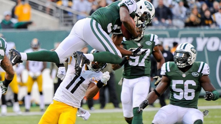 New York Jets free safety Jaiquawn Jarrett (37) intercepts a pass as Pittsburgh Steelers' Markus Wheaton (11) and teammates Demario Davis (56) watch him during the second half of an NFL football game, Sunday, Nov. 9, 2014, in East Rutherford, N.J. (AP Photo/Bill Kostroun)