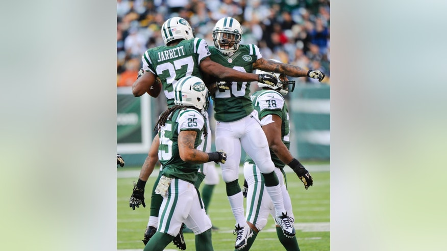 New York Jets free safety Jaiquawn Jarrett (37) celebrates an interception with Darrin Walls (30) during the second half of an NFL football game against the Pittsburgh Steelers, Sunday, Nov. 9, 2014, in East Rutherford, N.J. (AP Photo/Bill Kostroun)