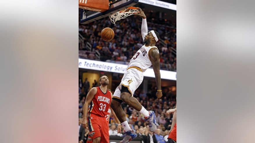 Cleveland Cavaliers' LeBron James dunks against the New Orleans Pelicans in the third quarter of an NBA basketball game Monday, Nov. 10, 2014, in Cleveland. James scored 32 points and added 12 rebounds and 10 assists to lead the Cavaliers to a 118-111 win. (AP Photo/Mark Duncan)