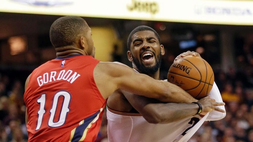 New Orleans Pelicans' Eric Gordon (10) could Cleveland Cavaliers' Kyrie Irving in the fourth quarter of an NBA basketball game Monday, Nov. 10, 2014, in Cleveland. Irving scored 32 points in Cleveland's 118-111 win. (AP Photo/Mark Duncan)