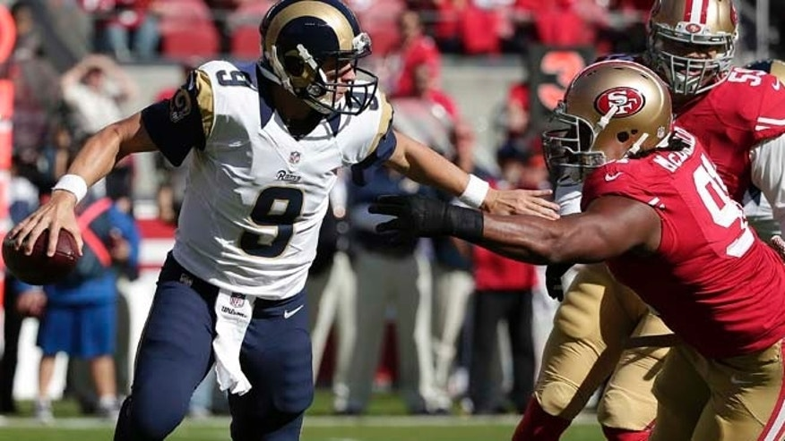 Nov. 2, 2014: St. Louis Rams quarterback Austin Davis (9) is pressured by San Francisco 49ers defensive tackle Ray McDonald (91) during the first quarter of an NFL football game in Santa Clara, Calif. (AP)