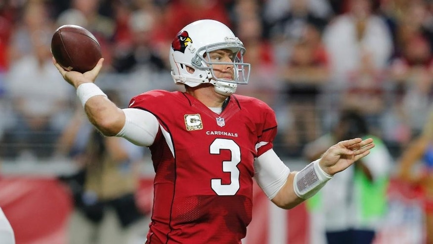 Arizona Cardinals quarterback Carson Palmer (3) throws against the St. Louis Rams during the second half of an NFL football game, Sunday, Nov. 9, 2014, in Glendale, Ariz. (AP Photo/Rick Scuteri)