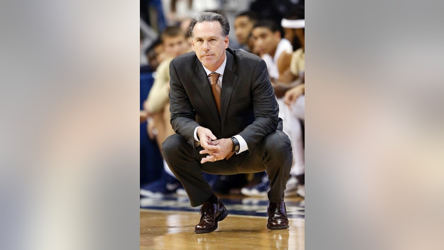 Pittsburgh head coach Jamie Dixon watches his team play against Philadelphia in the first of an exhibition NCAA college basketball game on Friday, Nov. 7, 2014, in Pittsburgh. (AP Photo/Keith Srakocic)