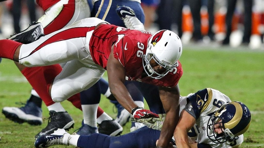 Arizona Cardinals defensive end Kareem Martin (96) sacks St. Louis Rams quarterback Austin Davis to cause a fumble for a touchdown during the second half of an NFL football game, Sunday, Nov. 9, 2014, in Glendale, Ariz. (AP Photo/Ross D. Franklin)