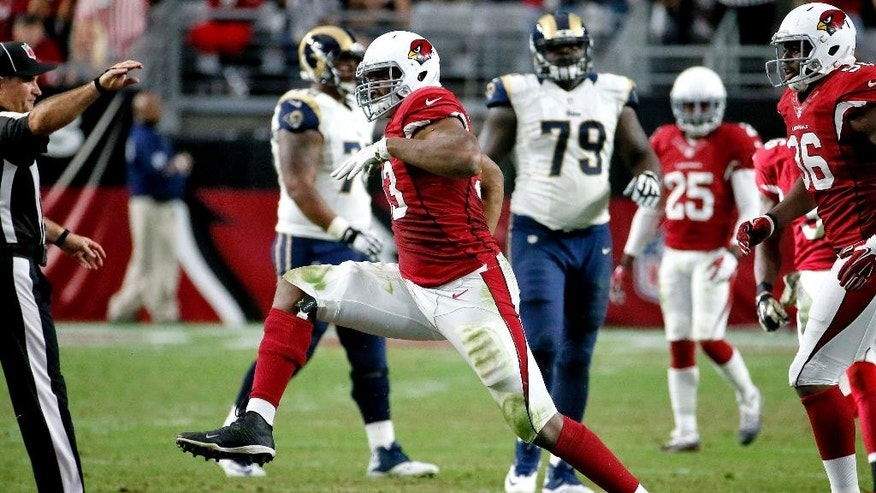 Arizona Cardinals defensive end Calais Campbell celebrates his sack of St. Louis Rams quarterback Austin Davis during the second half of an NFL football game, Sunday, Nov. 9, 2014, in Glendale, Ariz. (AP Photo/Matt York)