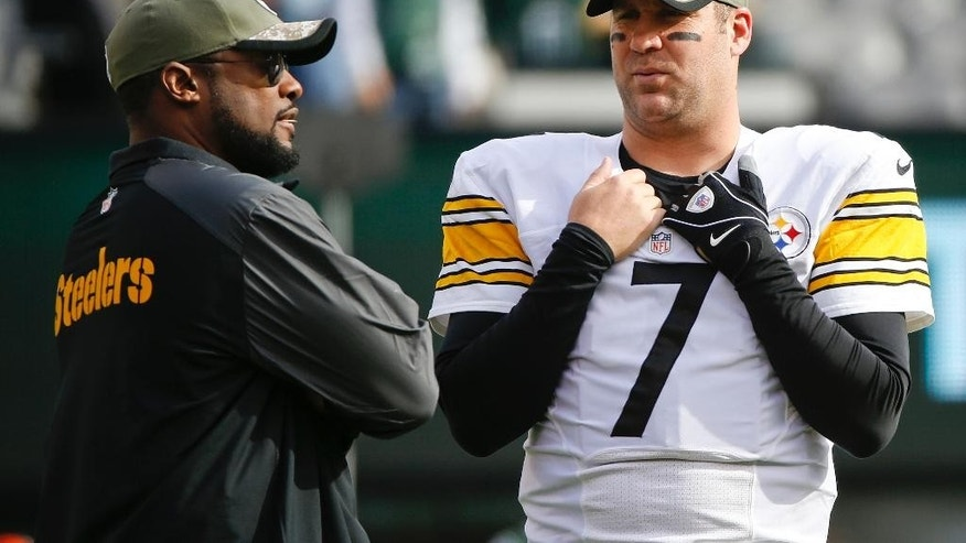 Pittsburgh Steelers quarterback Ben Roethlisberger (7) talks to head coach Mike Tomlin before an NFL football game against the New York Jets, Sunday, Nov. 9, 2014, in East Rutherford, N.J. (AP Photo/Kathy Willens)