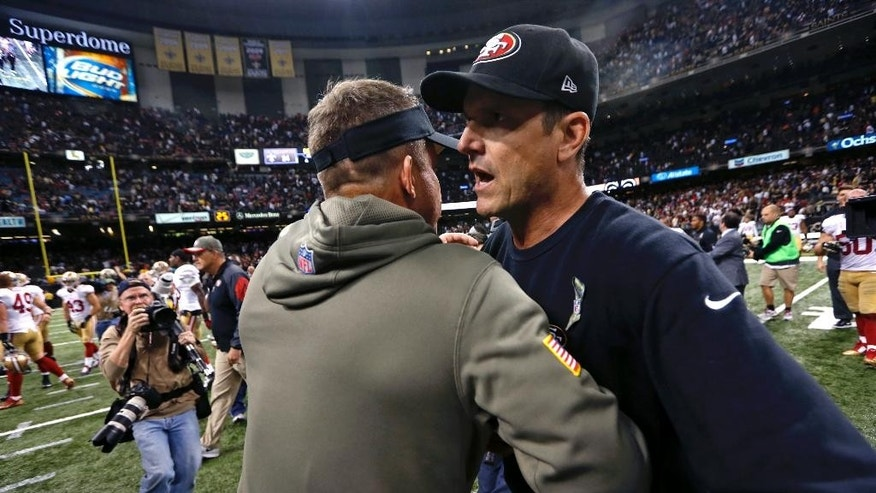 San Francisco 49ers  coach Jim Harbaugh, right, greets New Orleans Saints coach Sean Payton after an NFL football game in New Orleans, Sunday, Nov. 9, 2014. The 49ers won in overtime, 27-24.  (AP Photo/Jonathan Bachman)