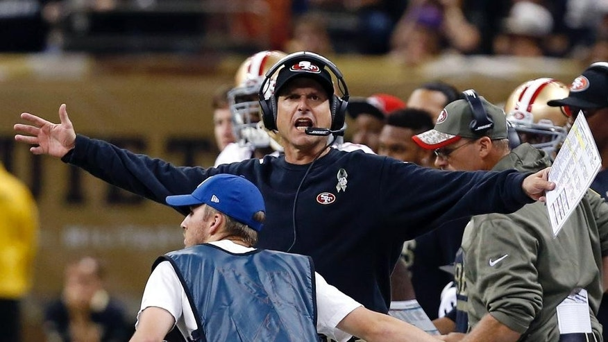 San Francisco 49ers head coach Jim Harbaugh calls out from the sideline in the first half of an NFL football game against the New Orleans Saints in New Orleans, Sunday, Nov. 9, 2014. (AP Photo/Jonathan Bachman)