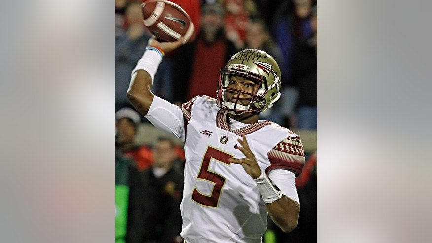 FILE - In this Oct. 30, 2014, file photo, Florida State quarterback Jameis Winston (5) looks to pass in the first half of a NCAA college football game against Louisville in Louisville, Ky.  No. 2 Florida State and Miami meet Saturday night, Nov. 15, 2014, the QB matchup will be a star-studded one. (AP Photo/Garry Jones, File)