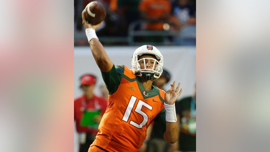 FILE - In this Sept. 6, 2014, file photo, Miami quarterback Brad Kaaya (15) throws a pass in the first half of an NCAA football game against Florida A&M in Miami Gardens, Fla. No. 2 Florida State and Miami meet Saturday night, Nov. 15, 2014, the QB matchup will be a star-studded one. (AP Photo/Lynne Sladky, File)