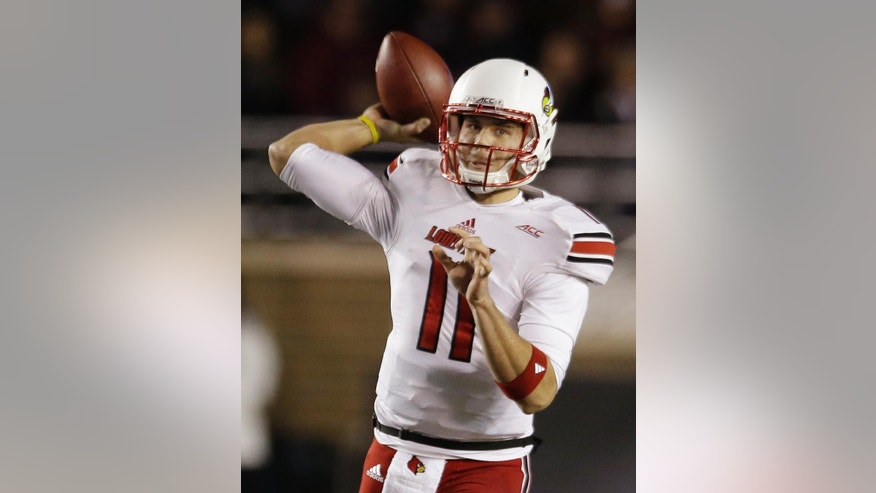 Louisville quarterback Will Gardner (11) throws a pass during the first quarter of an NCAA college football game against Boston College, Saturday, Nov. 8, 2014, in Boston. (AP Photo/Stephan Savoia)