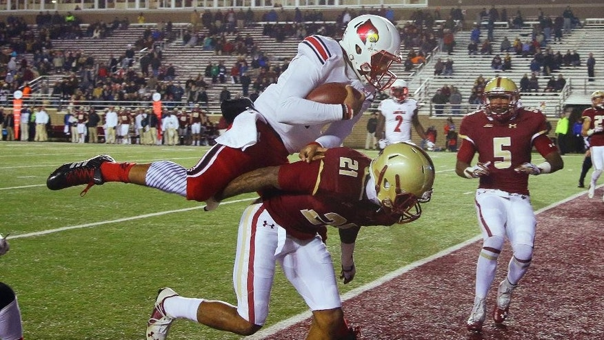 Louisville quarterback Reggie Bonnafon (7) jumps over the back of Boston College defensive back Manuel Asprilla (21) and into the end zone for the final score of an NCAA college football game Saturday, Nov. 8, 2014, in Boston. Louisville defeated Boston College 38-19. (AP Photo/Stephan Savoia)