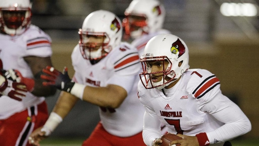 Louisville quarterback Reggie Bonnafon (7) scrambles out of the pocket during the second half of an NCAA college football game against Boston College on Saturday, Nov. 8, 2014, in Boston. Louisville defeated Boston College 38-19. (AP Photo/Stephan Savoia)