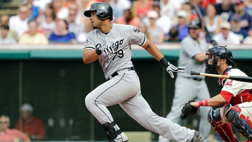 FILE - This July 12, 2014, file photo shows Chicago White Sox's Jose Abreu batting against the Cleveland Indians during a baseball game in Cleveland.   Abreu was a unanimous winner of the AL Rookie of the Year award, Monday Nov. 10, 2014.   (AP Photo/Mark Duncan, File)