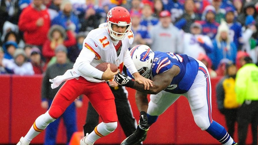 Buffalo Bills defensive tackle Marcell Dareus, right, tugs at the jersey of Kansas City Chiefs quarterback Alex Smith during the first half of an NFL football game, Sunday, Nov. 9, 2014, in Orchard Park, N.Y. (AP Photo/Gary Wiepert)