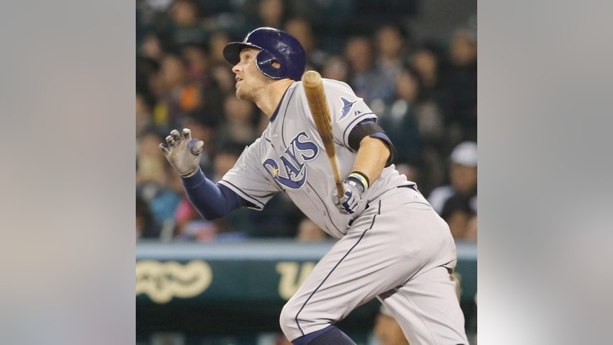 U.S. All Star team, Tampa Bay Rays Evan Longoria hits a homerun with bases loaded against Japan's Giants/Tigers team in the fifth inning at Japan US All Star baseball in Nishinomiya, western Japan, Tuesday, Nov. 11, 2014. (AP Photo/Kyodo News) JAPAN OUT, MANDATORY CREDIT