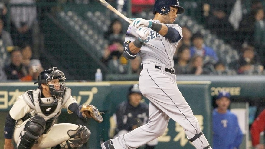U.S. All Star team, Seattle Mariners Robinson Cano hits against Japan's Giants/Tigers team in the first inning at Japan US All Star baseball in Nishinomiya, western Japan, Tuesday, Nov. 11, 2014. (AP Photo/Kyodo News) JAPAN OUT, MANDATORY CREDIT