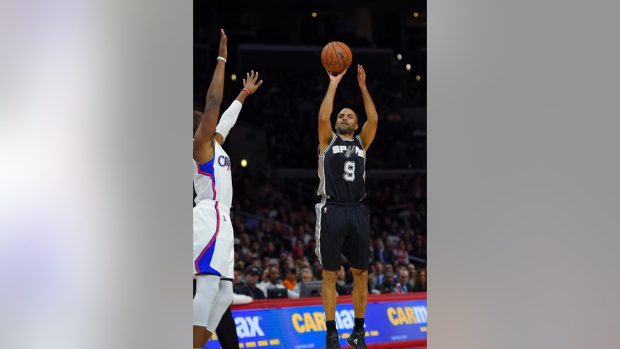 San Antonio Spurs guard Tony Parker, right, of France, puts up a shot as Los Angeles Clippers guard Chris Paul defends during the first half of an NBA basketball game, Monday, Nov. 10, 2014, in Los Angeles. (AP Photo/Mark J. Terrill)