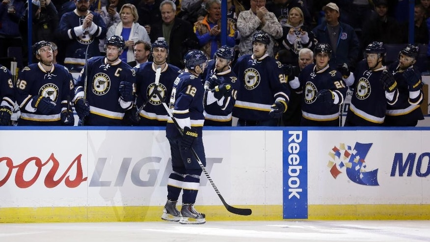 St. Louis Blues' Jori Lehtera, of Finland, is congratulated by teammates as he skates by the bench after scoring his second goal of an NHL hockey game, in the second period against the Buffalo Sabres on Tuesday, Nov. 11, 2014, in St. Louis. Lehtera followed with another goal in the second period for the hat trick. (AP Photo/Jeff Roberson)