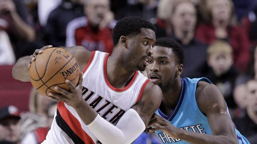 Charlotte Hornets forward Michael Kidd-Gilchrist, right, plays tight defense on Portland Trail Blazers guard Wesley Matthews during the first half of an NBA basketball game in Portland, Ore., Tuesday, Nov. 11, 2014.(AP Photo/Don Ryan)